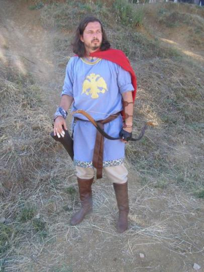 """Modern reconstruction of 6th cent urban militiaman from the Hellenic horseback archery society. HIs blue tunic marks him as a member of the """"Blues Circus Fraction"""". The double head eagle though appeared after the 14th century."""