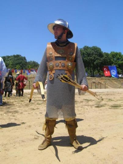 Modern reconstruction of 14th cent Byzantine Militia officer from the Hellenic horseback archery society, based on contemporary frescoes from Ochrid. The helmet shows western influence. Armor courtesy of hellenicarmors.gr and boots courtesy living history association Koryvantes