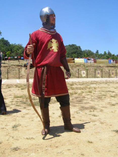 "Modern reconstruction of 15th cent Byzantine archer from the Hellenic horseback archery society, based on contemporary icons of the Crucifixtion. The helmet shows western (italian) influence and it is based on findings from ""Chalcis Armory"". The double head eagle though is again unlikely as it was strictly an imperial family emblem and chroniclers talk about a double lion emblem. Armor courtesy of hellenicarmors.gr and boots courtesy living history association Koryvantes"
