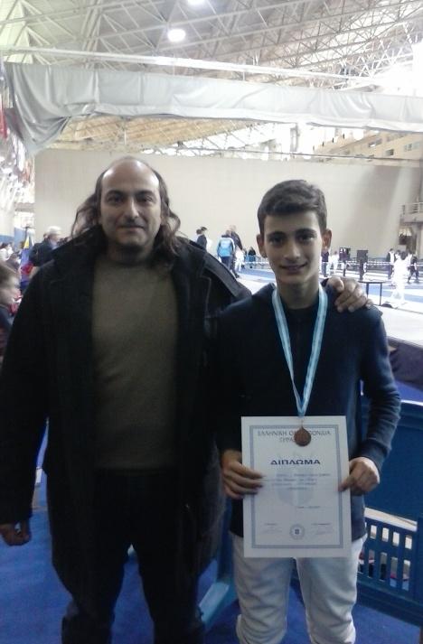 Ο Διονύσιος Ρούντης, με τον προπονητή του Γεώργιο Ε. Γεωργά