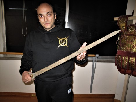Mr. George E. Georgas with a Mycenaean sword